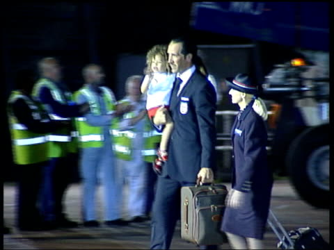 england players home night england captain david beckham along from plane lms england keeper david seaman along carrying daughter ms england manager... - 2002 stock videos & royalty-free footage