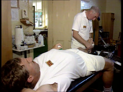 england team 1700 same as 2045 australia sydney ms england physiotherapist laurie brown treating ian botham as derek pringle looks on cms brown bv... - cricket ball stock videos & royalty-free footage