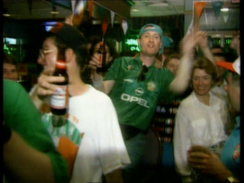 world cup finals: ireland beat italy; usa: new york: new york city: int two woman singing and dancing sot more irish fans celebrating and drinking... - international team soccer stock videos & royalty-free footage