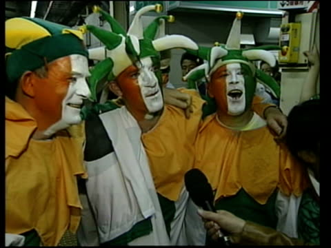 France eliminated/Ireland through ITN JAPAN Yokohama Group of Irish football fans singing as celebrating World Cup victory over Saudi Arabia...