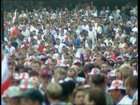 world cup host row; lib wembley stadium: england fans milling outside stadium: england fan having face painted with st george's cross: - fan enthusiast stock videos & royalty-free footage