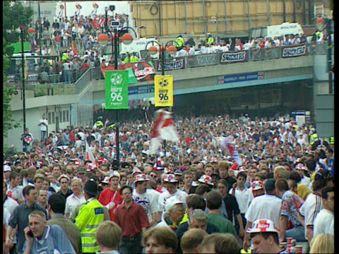 world cup host row lib england fans milling outside stadium england fan having face painted with st george's cross - body adornment stock videos and b-roll footage