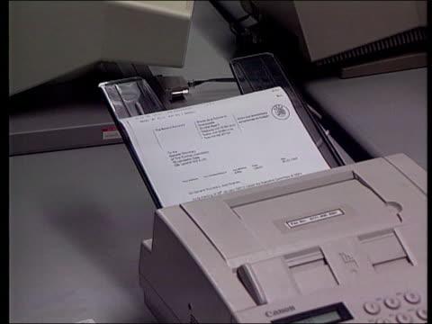 itn fax coming thru machine freeze - fax machine stock videos & royalty-free footage