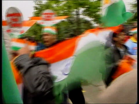 india v pakistan gc5l peter england manchester old trafford pakistan cricket fan shouting out of open car window pull out to show pakistani flag held... - pakistani flag stock videos & royalty-free footage
