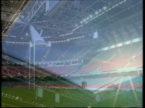 world cup preparations gv exterior completed millennium stadium with reflection showing in water gv empty seating area of new stadium pan la sky seen... - millennium stadium stock videos & royalty-free footage