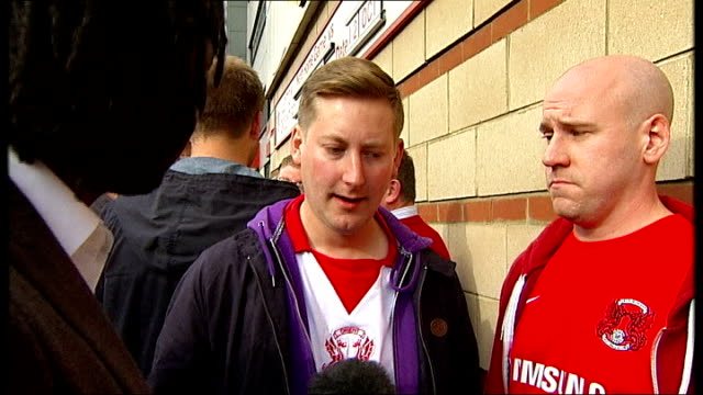 england beat montenegro leyton brisbane road reporter to camera vox pops 'leyton orient football club' sign on wall fans outside brisbane road... - leyton orient f.c stock videos and b-roll footage
