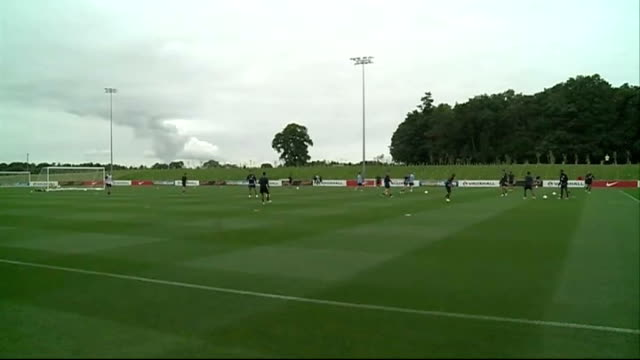 england training session players kicking balls about at training session/ gareth southgate directing u21 team training session - jugendmannschaft stock-videos und b-roll-filmmaterial