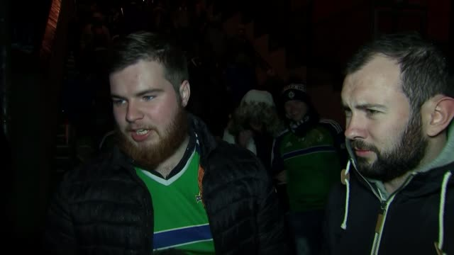 northern ireland lose to switzerland vox pops sot various of fans away from the ground after the game reporter to camera sot - playoffs stock videos and b-roll footage