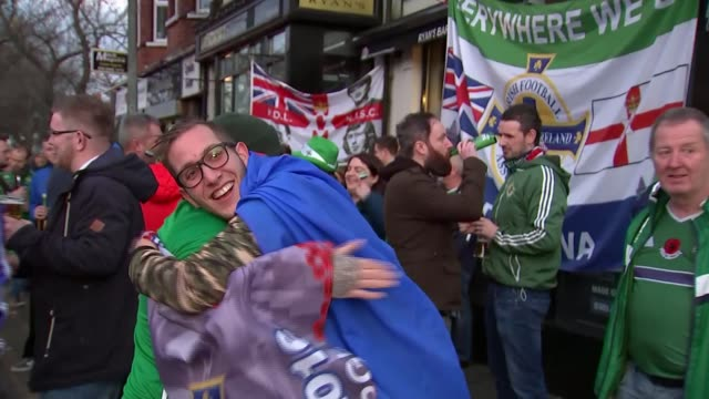 northern ireland lose to switzerland northern ireland belfast ext various of northern ireland and swiss football fans on the street before their 218... - playoffs stock videos and b-roll footage