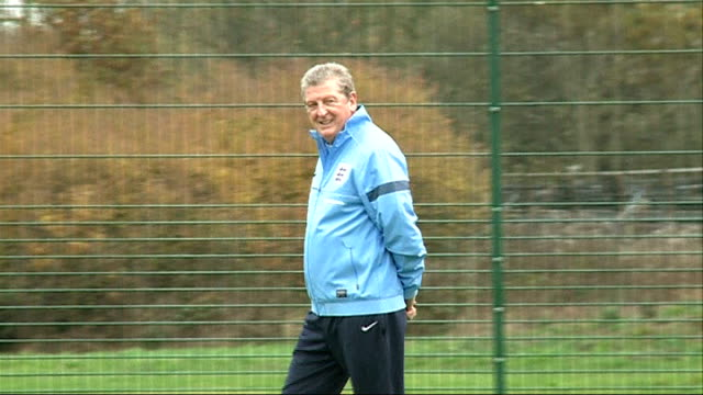 roy hodgson concerned with world cup venues in brazil england london larkspur rovers fc ext roy hodgson on pitch at fa 'just play' training session... - 2014年点の映像素材/bロール