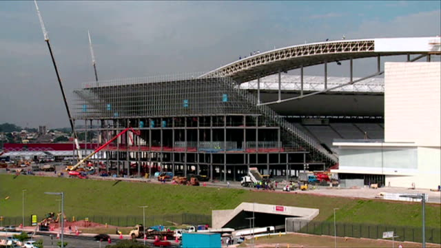 Sao Paulo stadium inauguration building work still incomplete General view of Itaquerao Stadium Construction workers at work on section of incomplete...