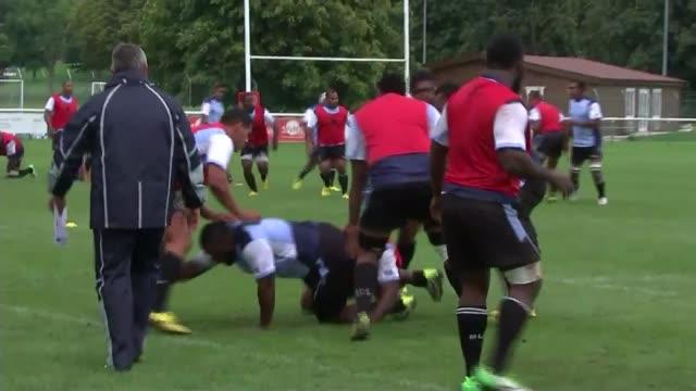 world cup: schoolchildren welcome fiji team to uk; hampshire: aldershot: various of fiji rugby team training - aldershot stock videos & royalty-free footage