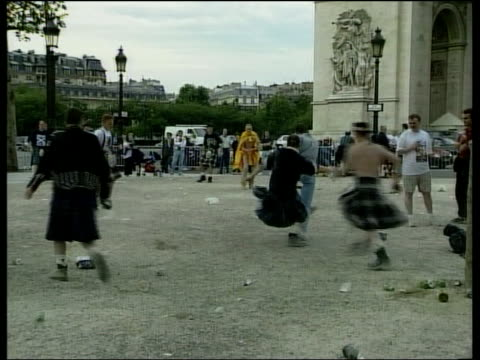 scottish fans in paris france paris ext gvs scotland fans playing football with beer bottles beneath eiffel tower scotland fans beneath eiffel tower... - beer cap stock videos & royalty-free footage