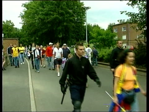english colombian fans police strolling along towards ms police ordering english fans out of car c4n - lens pas de calais stock videos & royalty-free footage