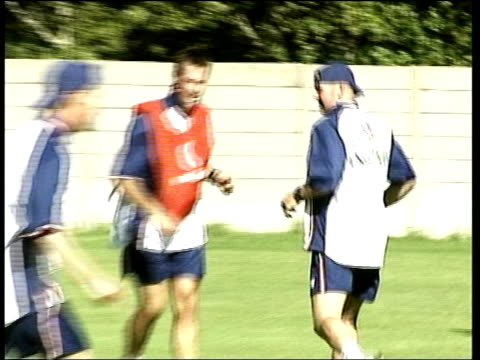 Still no decision over Zimbabwe match ITN AFRICA England cricketers playing football in training session Nasser Hussain running along as playing...