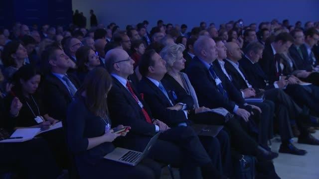 world economic forum 2016: david cameron negotiating eu reform in davos; audience sat listening to cameron speech - reform stock-videos und b-roll-filmmaterial