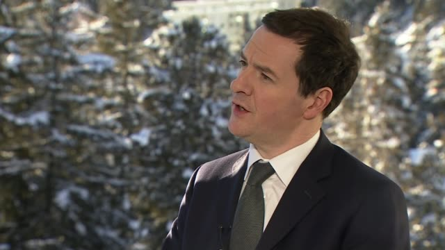 world economic forum 2016: george osborne interview; switzerland: davos: 2016 world economic forum: ext / snow george osborne along road with others/... - stick plant part stock videos & royalty-free footage