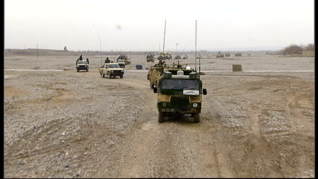 afghan president rejects role for paddy ashdown as envoy tx helmand province musa qala british troops leading armoured convoy through taliban... - paddy ashdown stock-videos und b-roll-filmmaterial