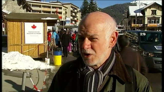 World Economic Forum in Davos EXT Howard Davies interview SOT Nick Clegg MP along TRACK Chesley B Sullenberger 111 chatting to unidentified man...