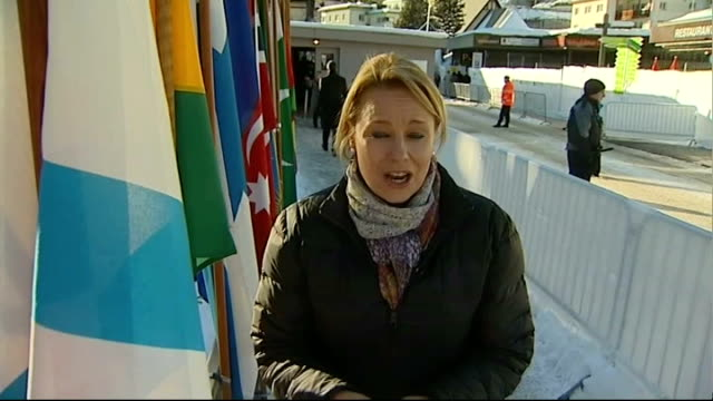 World Economic Forum in Davos EXT Reporter to camera ITN reporter speaking to Will Hutton Will Hutton interview SOT ITN reporter towards past next...