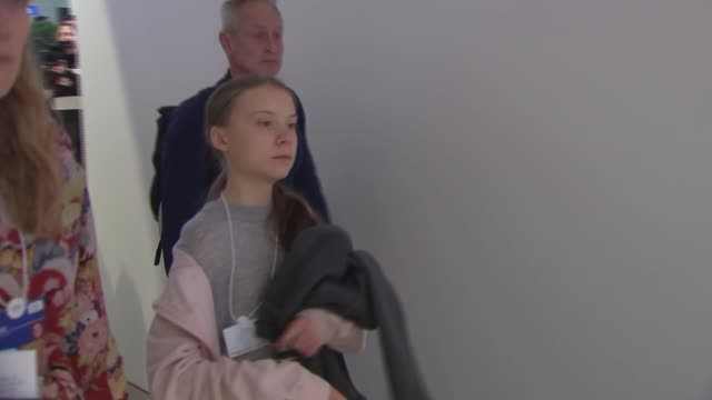 prince charles meets greta thunberg switzerland davos photography** prince charles prince of wales along in corridor and chatting with people as... - ダボス点の映像素材/bロール