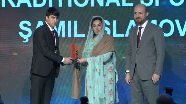 world ethnosport confederation head bilal erdogan presents award to prof dr mehmet turkmen erdogan and pakistani inter provincial coordination... - traditional sport stock videos & royalty-free footage