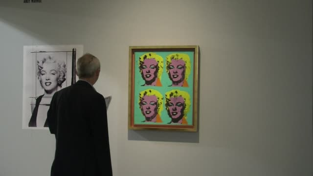 world famous art works have been flying off the exhibition walls at switzerlands accalimed artbasel show with collectors snapping up pieces by sergei... - snapping stock videos & royalty-free footage