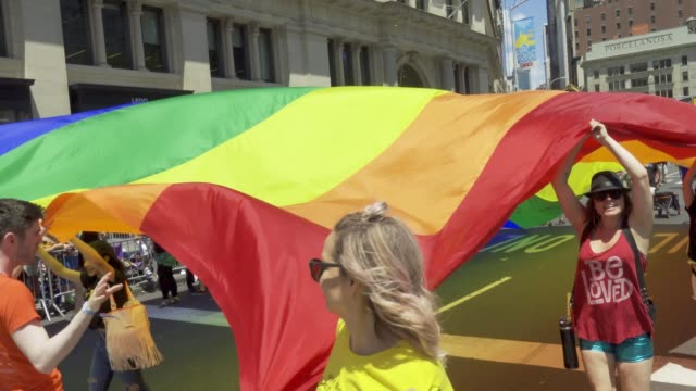 world gay pride nyc commemorating the 50th anniversary of the stonewall riots/uprising. . - placard stock videos & royalty-free footage
