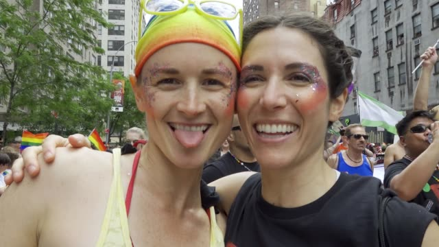world gay pride nyc commemorating the 50th anniversary of the stonewall riots/uprising. . - kissing stock videos & royalty-free footage