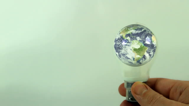 world in a light bulb. hd - solutions stock videos and b-roll footage