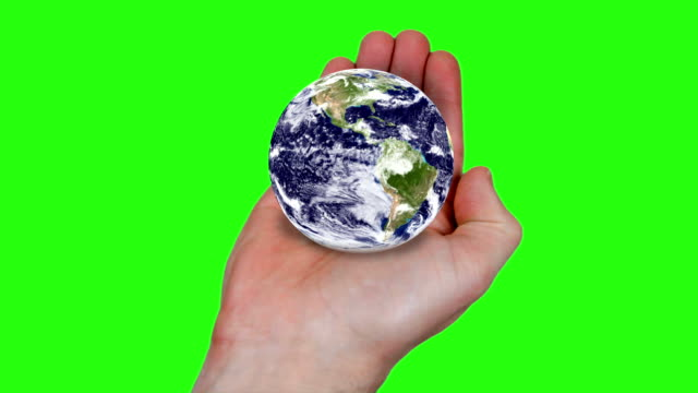 world in your hands - green screen. hd - matte image technique stock videos & royalty-free footage