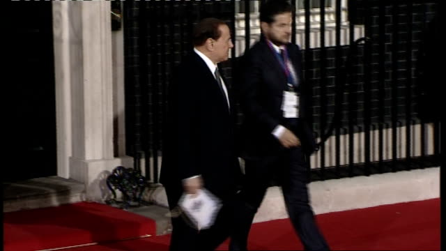 world leaders and other guests leaving number ten following g20 dinner; ban ki-moon out of number ten with his wife ban soon-taek / abhisit vejjajiva... - zaum stock-videos und b-roll-filmmaterial