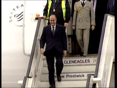World leaders at Gleneagles whilst protesters clash with police SCOTLAND Prestwick Airport LMS Jacques Chirac down steps of aircraft unseen miliraty...
