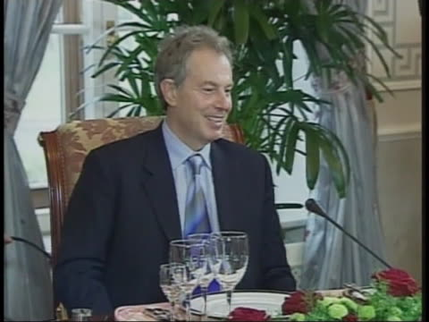 world leaders enter a banquet room as prime minister tony blair waits at the head of the table during the 2005 g8 summit. - (war or terrorism or election or government or illness or news event or speech or politics or politician or conflict or military or extreme weather or business or economy) and not usa stock videos & royalty-free footage