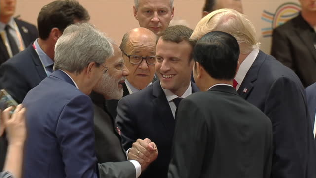 world leaders including narendra modi emmanual macron and donald trump greet each other at the g20 summit in hamburg july 2017 - präsident stock-videos und b-roll-filmmaterial