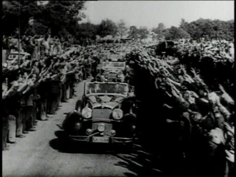 1939 world leaders on parade in open convoys / germany and france - medium group of objects stock videos & royalty-free footage