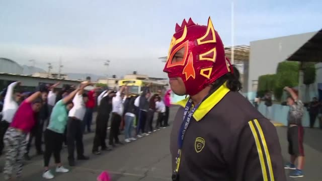 World lucha libre champion Dragon Rojo Jr has been training local police in a rough Mexico City neighbourhood to teach them how to restrain suspects...