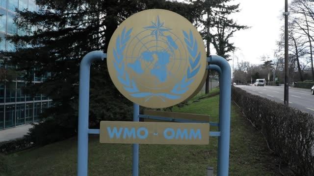 vidéos et rushes de world meteorological organization sign at the entrance of the headquarters on february 18, 2020 in geneva, switzerland. - organisation