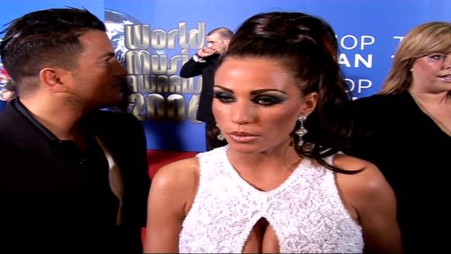 world music awards 2006: celebrity red carpet arrivals and interviews / winners room interviews; jordan and andre interview on red carpet sot - on... - レイチェル ハンター点の映像素材/bロール