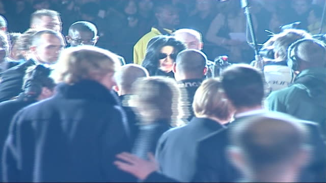 celebrity red carpet arrivals and interviews / winners room interviews more of jackson signing autographs for and waving at screaming fans sot / more... - autographing stock videos & royalty-free footage