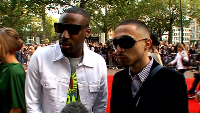 world premiere of '4.3.2.1' in london: interviews with stars of the film; adam deacon and bashy interview sot - oon looking good * on the fans... - バンド アメリカ点の映像素材/bロール