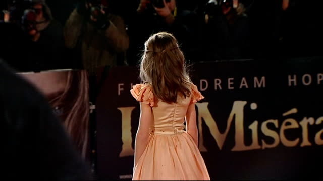 world premiere of 'les miserables' film; england: london: leicester square: ext/night isabelle allen on red carpet at 'les miserables' film premiere... - russell crowe stock videos & royalty-free footage