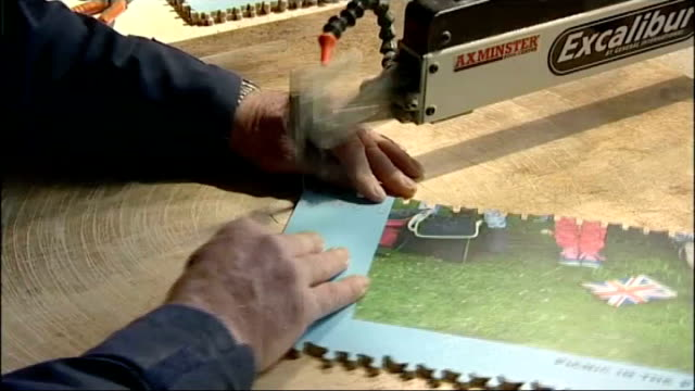 world record attempt jubilee jigsaw collapses dave evans interview sot evans cutting jigsaw pieces with jigsaw evans interview sot evans putting in... - world record stock videos & royalty-free footage