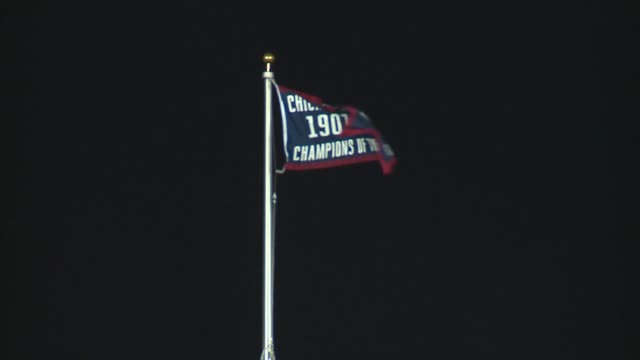 world series championship banners raised at the 2017 chicago cubs home opener in wrigley field in chicago on april 10 2017 - baseball world series stock-videos und b-roll-filmmaterial