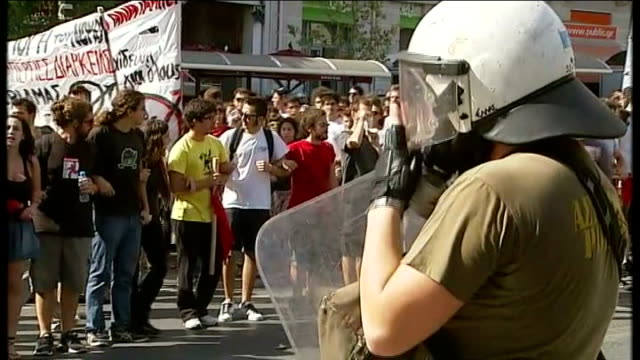 World stock markets react to fears of doubledip recession GREECE Athens EXT Shots of demonstrators taking part in protest march against austerity...