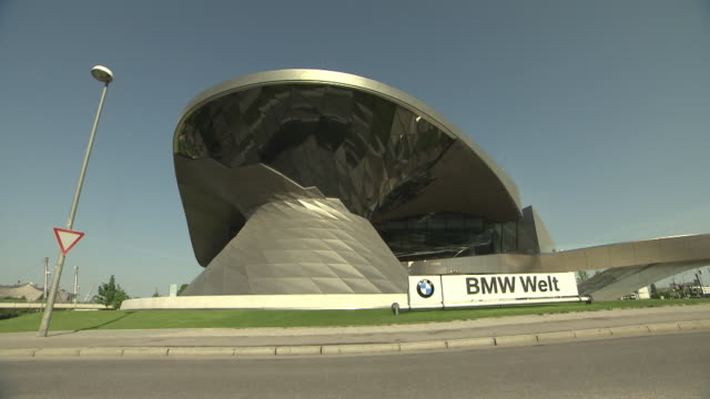 bmw world, street,trees, blue sky, lawn, sunny, architecture - western script stock videos & royalty-free footage