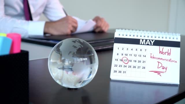 world telecommunications day - special days - abbigliamento da lavoro formale video stock e b–roll