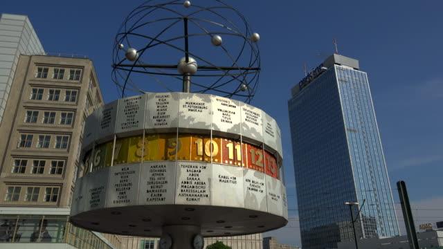 world time clock on alexanderplatz square and plaza hotel, berlin, germany - alexanderplatz stock videos & royalty-free footage