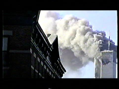 vídeos de stock, filmes e b-roll de world trade center burning after terrorist attack on september 11 2001 in new york new york - 2001