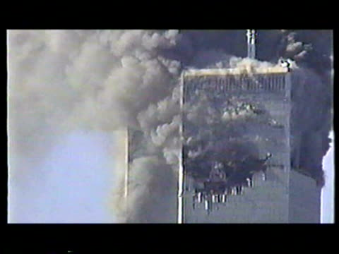 world trade center burning after terrorist attack on september 11, 2001 in new york, new york - terrorism stock videos & royalty-free footage